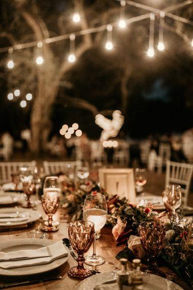 Outdoor wedding breakfast with macrame decor