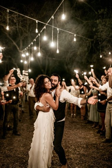 Sparkler exit for bride in Max Mara wedding dress and groom