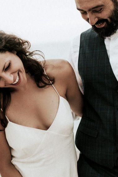Bride in spaghetti strap wedding dress from Max Mara