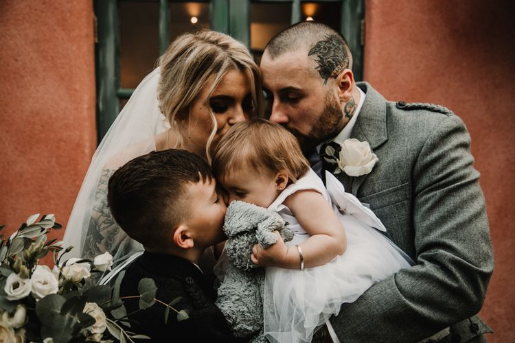 Bride, Groom and Their Children Embracing