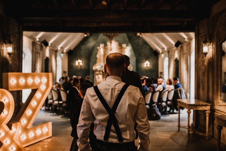 Groomsman in Braces Walking Down the Le Petit Chateau Aisle