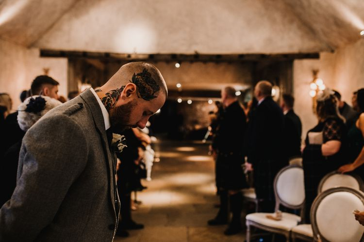 Groom in Highland Wear Standing at the Altar