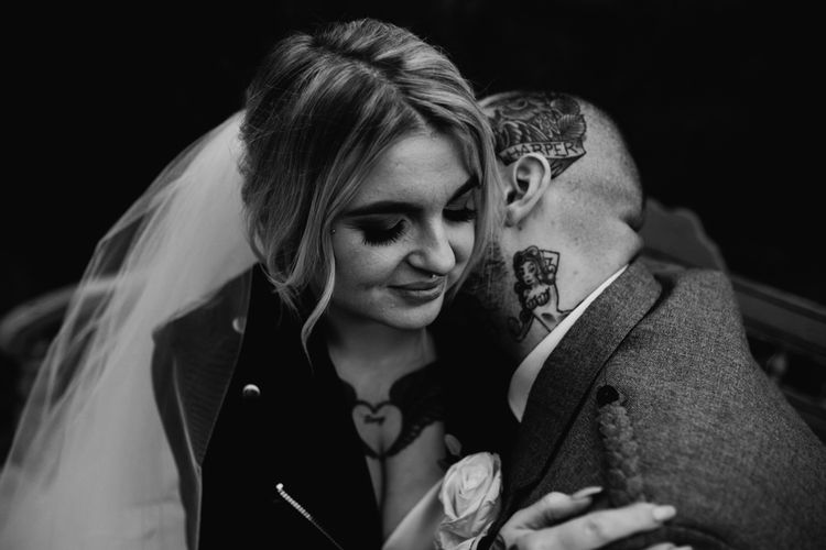 Tattooed Groom Kissing His Brides Neck in Leather Jacket