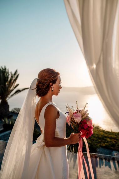 Bride in Pronovias wedding dress at Santorini wedding