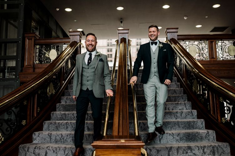 Groom and groom walking down the stairs at Titanic Hotel Liverpool wedding