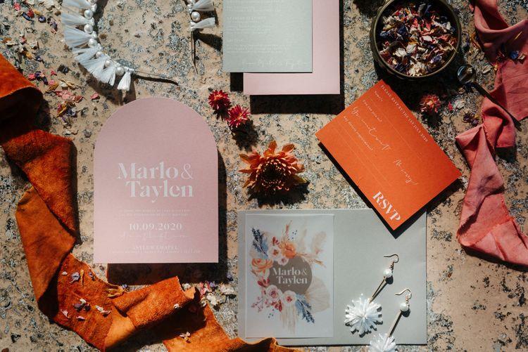 Pink and orange wedding stationery designs by Wonderland Invites