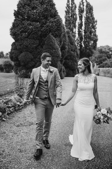 black and white portrait of the bride and groom by Natalie J Weddings