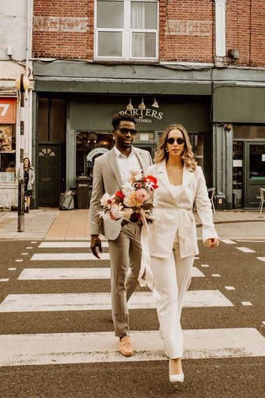 Stylish bride and groom crossing the street at Portsmouth city elopement