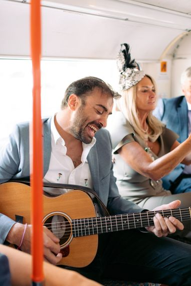 Wedding party singing on the way to the reception on London bus