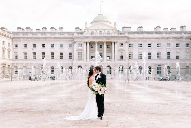 Bride and groom kissing at Somerset House wedding