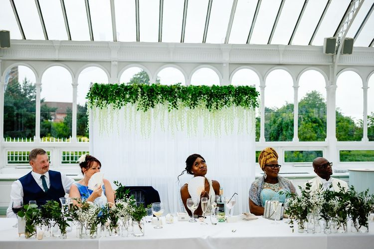 Top table backdrop with fabric and flowers