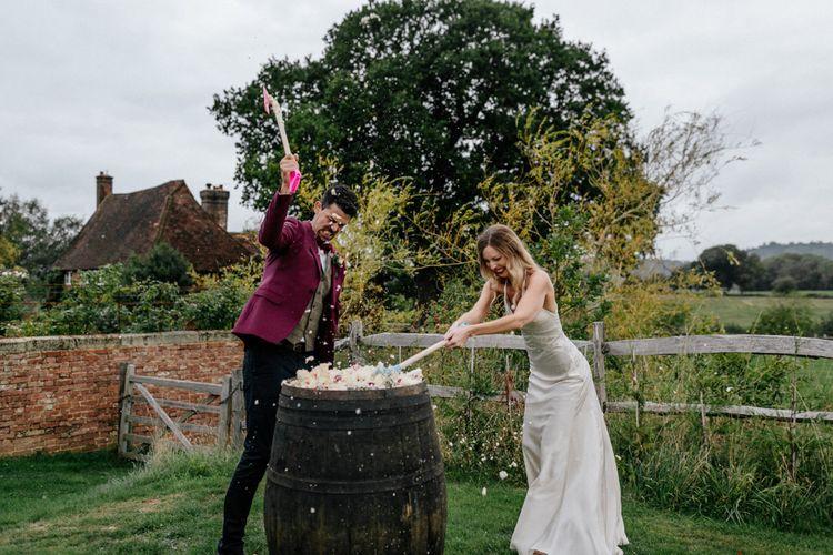Bride and groom wedding cake smash