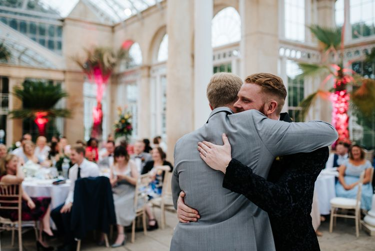 Groom embracing his best man after the speeches