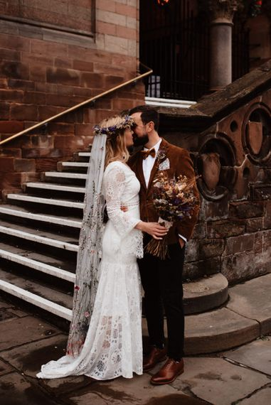 Bride and groom kissing outside Chester Town Hall