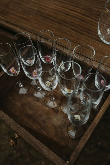 Champagne glasses decorated with edible flowers