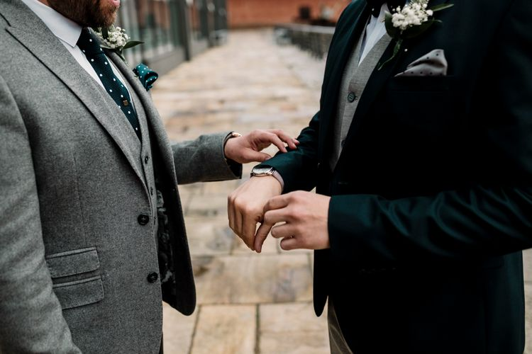 Grooms at first look showing their wedding watches