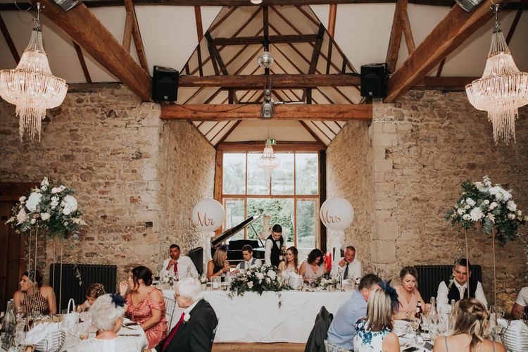 Notley Abbey wedding reception decor with Giant Mr & Mrs balloons