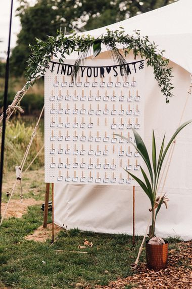 Peg board wedding table plan for a budget wedding