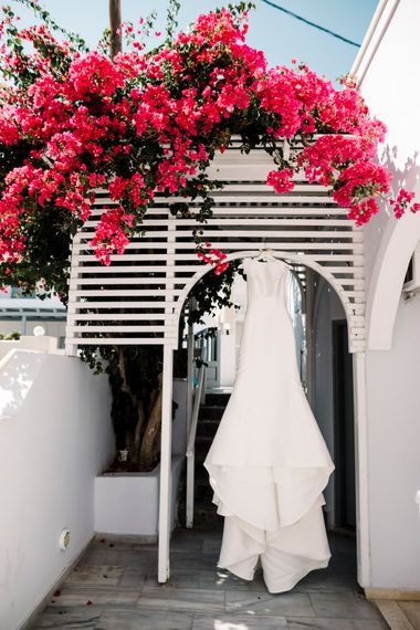 Pronovias wedding dress hanging up at Santorini wedding