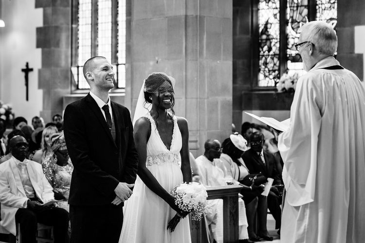 Bride and groom exchanging vows at St Nicholas Church in Liverpool