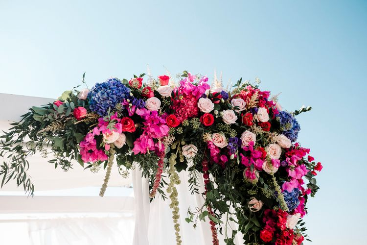 Jewel coloured wedding flowers at Santorini wedding