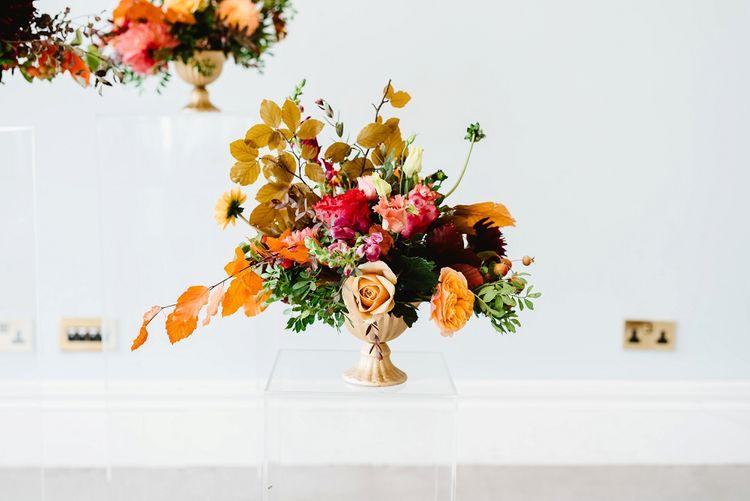 Tall autumn floral arrangement at Carlton House Terrace wedding reception