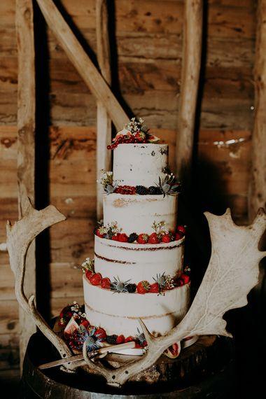 Semi naked wedding cake decorated with fruits