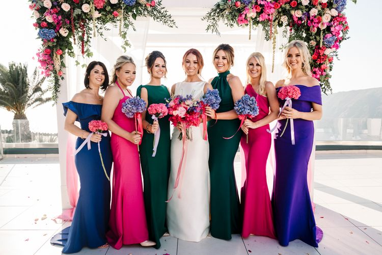 Bridal party portrait with bridesmaids in jewel dresses