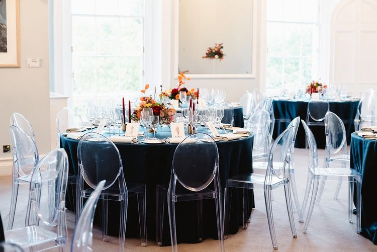 Sophisticated reception tables at Carlton House Terrace wedding with teal linens and ghost chairs