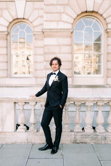 Groom wearing Topman suit for black tie wedding in London