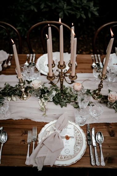 Place setting with vintage cutlery and tableware