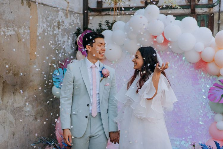 Holographic pastel festival wedding by Fresh Meat Workshop and Jump The Broom