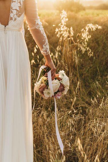 Bride clutches beautiful bouquet