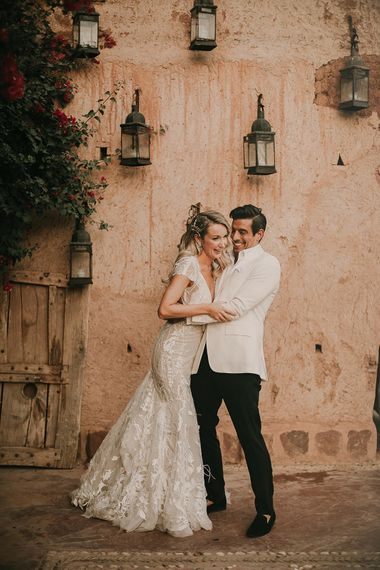 Bride in Berta wedding dress and groom in white dinner jacket at Marrakech wedding