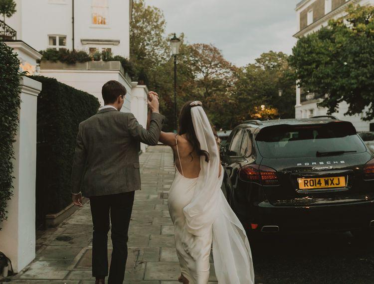 Bride and groom walking down the street in London