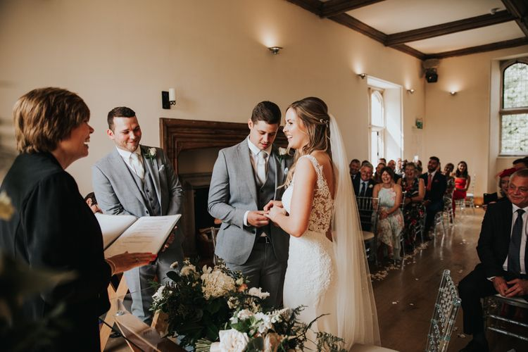 Bride and groom exchanging vows at Notley Abbey wedding ceremony