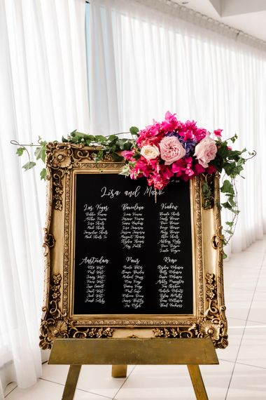 Gold guilt mirror table plan for Santorini wedding