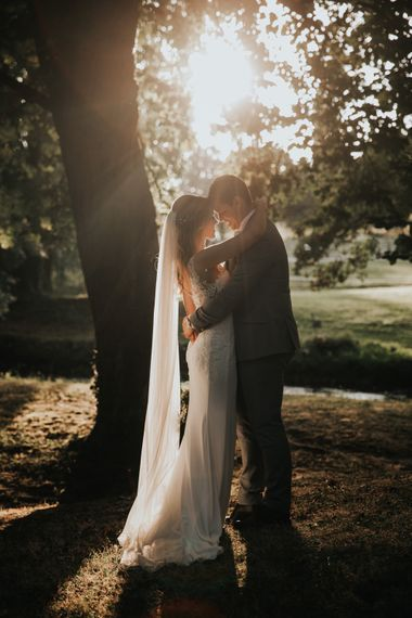 Golden hour bride and groom portrait by Natalie J Weddings