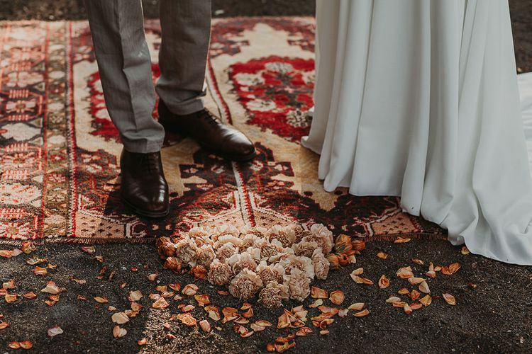 Woolen Rug and flower at the altar