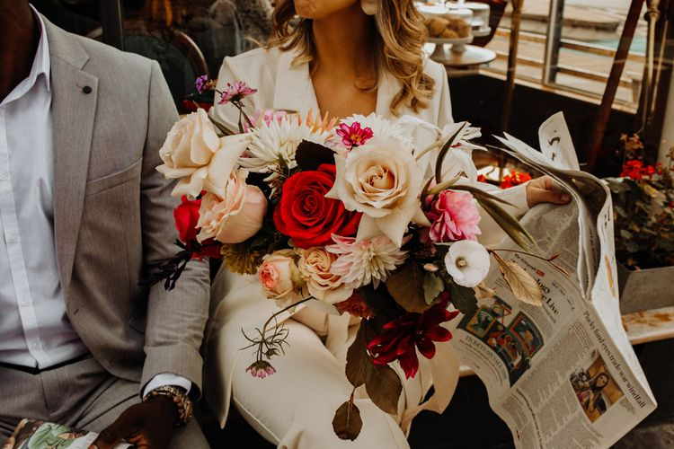 Pink, red and ivory wedding bouquet for city elopement