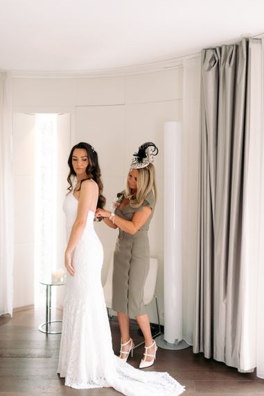 Bride to be getting ready for London wedding with mother of the bride
