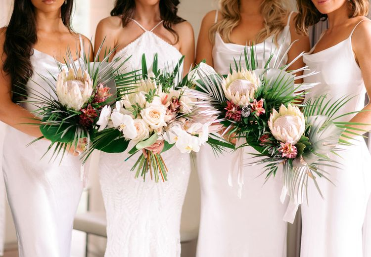 King Protrea wedding bouquets held by bridal party