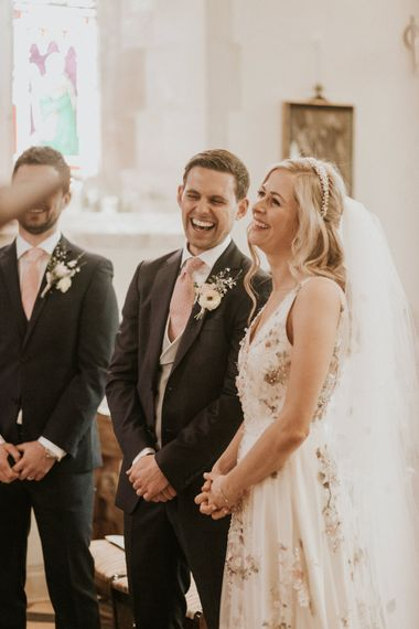 Bride and groom smiling during the church wedding ceremony