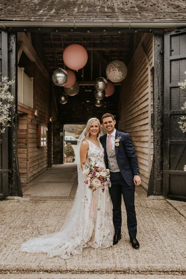Bride and groom portrait by Nataly J Photography outside Upwaltham Barns