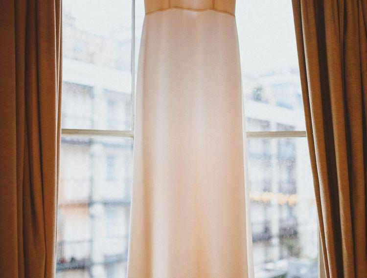 Wedding dress hanging before Chelsea London wedding