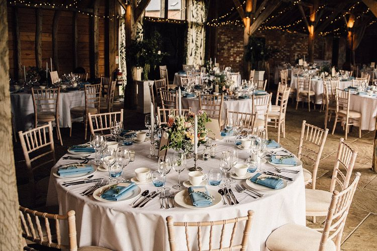 round tables with classic wedding decor at rustic barn wedding reception