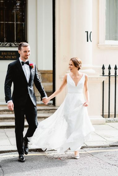Bride in Stephanie Allin wedding dress and groom in tuxedo at black tie wedding