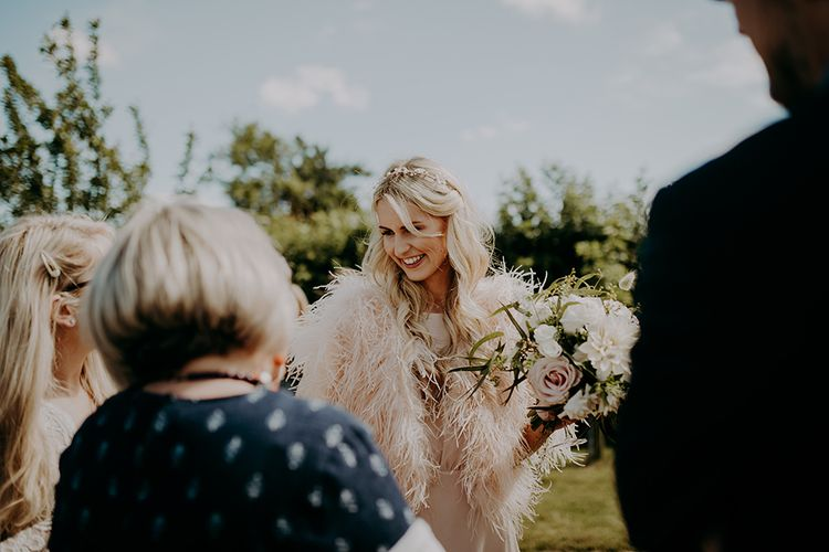 Bridesmaid in feather coverup