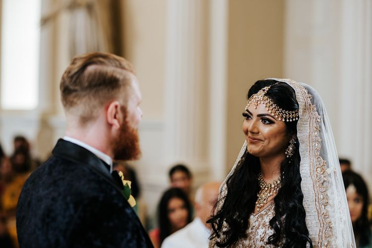 Indian bride in Ivory and Gold embellished dress and veil