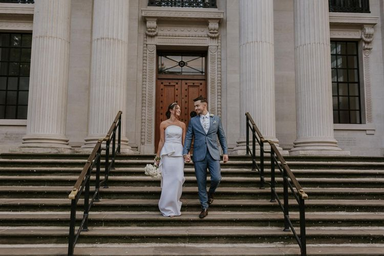 Bride and groom on the steps at Old Marylebone Town Hall